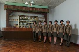 #38. (From L-R) AN YONG OK, 31 (Artist), PAK KUN JU, 23, JONG CHUN HUI, 23, U RYON MI, 28, LEE SONG JUK, 25, KIM HYANG MI, 20,(Waitresses), JONG YONG SIL, 42(Manager), Panmun Gak