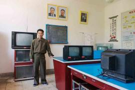#41. LI WON SIK, 49, Teacher, Electronics Club Classroom, Kaesong Schoolchildren's Palace.